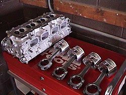 Cylinder head and pistons; engine rebuild